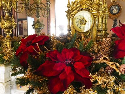 The mantelpiece in the Drawing Room adorned with gilt and silver hues and Gilded Age inspired decorations designed by Danna DiElsi, owner of The Silk Touch in Norwalk, CT.