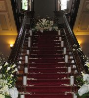 The Grand Staircase Decorated for a Private Event at the Lockwood Mathews Mansion Museum Courtesy of Jodi Engelmann